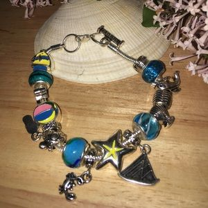Bracelet with summer charms theme.